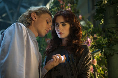 Jace (Jamie Campbell Bower) shows Clary (Lily Collins) Shadowhunter treasures