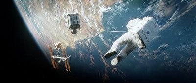 Astronaut Kowalski (George Clooney) tows Stone (Sandra Bullock) to safety