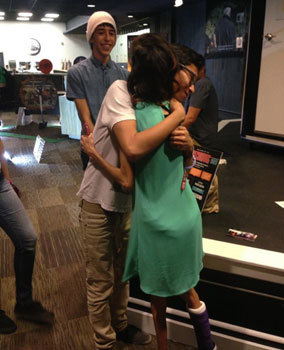 Lizzie hugging a fan