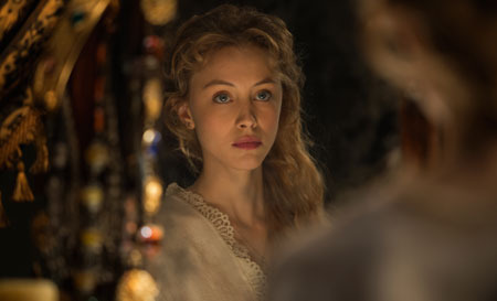Mirena (Sarah Gadon) worries about her husband