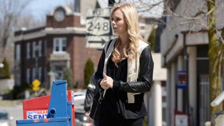 Elena returns to Stonehaven where her pack still lives
