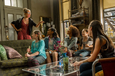 Miss Hannigan (Cameron Diaz) and foster girls in tiny apartment