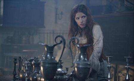 Cinderella (Anna Kendrick) slaves away.