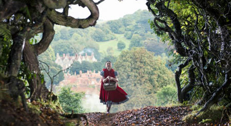 Little Red (Riding Hood) skips into the woods