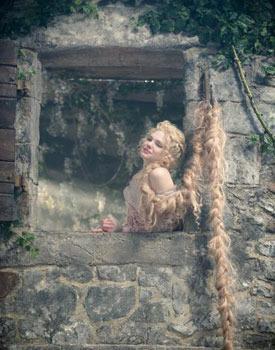 Rapunzel (MacKenzie Mauzy) lets down her hair