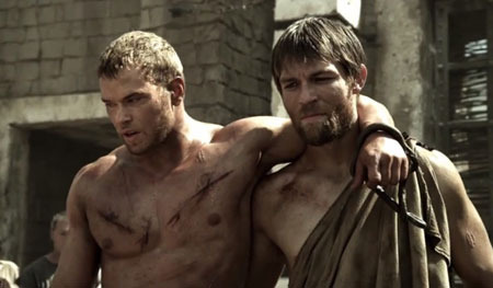 A battered Hercules with buddy Sotiris (Liam McIntyre)