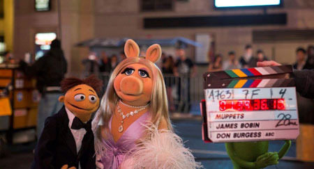 Miss Piggy and Walter on set