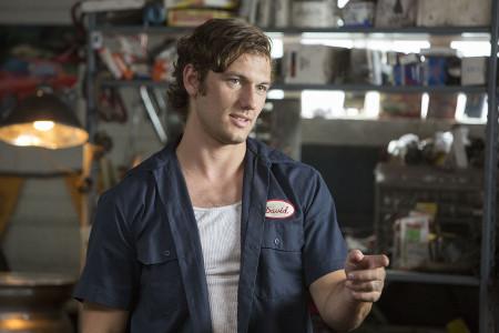 David working at his dad's mechanic shop