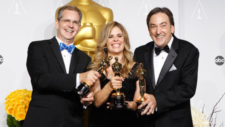 Holding their Oscar's backstage