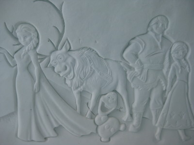 The characters of Frozen sculpted on the wall at the Ice Hotel
