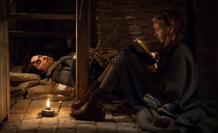 Liesel reads to Max