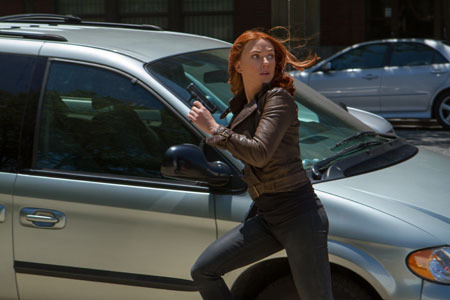 Natasha (Scarlett Johansson) runs from Winter Soldier attack