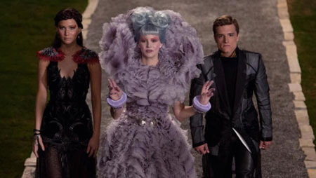 Katniss, Effie, and Peeta at the Capitol Party