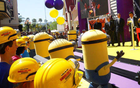 Crowd watches Mario Lopez announce ride opening