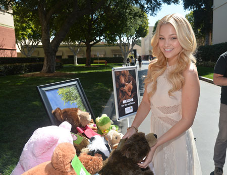 Olivia with the donated plush bears
