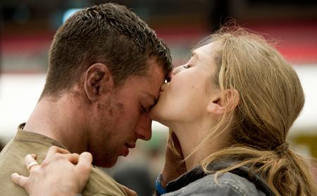 Elle (Elizabeth) greets warrior hubby Ford (Aaron Taylor Johnson)