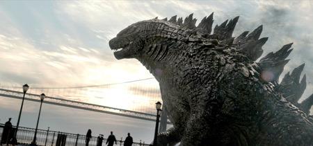 Godzilla strolls on a bridge