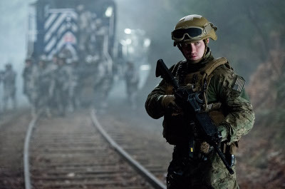 Ford (Aaron Taylor-Johnson) guards a trainload of nukes