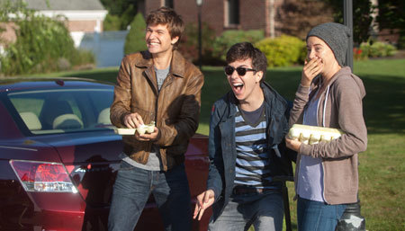 Gus, friend Isaac (Nat Wolff) and Hazel throw eggs as a prank
