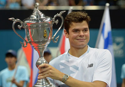 Milos holds his trophy from the ATP Thailand Open tennis tournament in Bangkok 2013