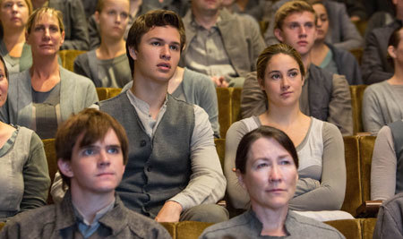 Tris (Shailene Woodley) sits next to brother (Ansel Elgort) at choosing ceremony