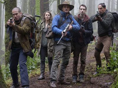 Ellie (Keri Russell), Malcolm (Jason Clarke) and Alex (Kodi Smit-McPhee) enter ape country