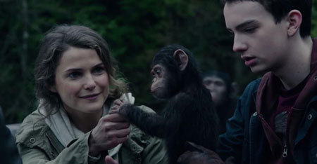 Ellie and Alexander are awed by a new ape baby
