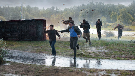 Trey (Nathan Kress), family and friends run from the storm