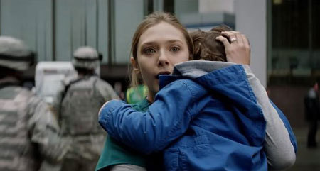 Ford's wife (Elizabeth Olsen) protects their son