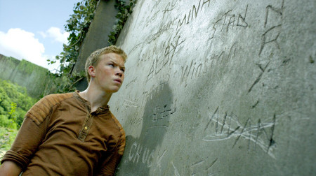 Gally (Will Poulter) checks the boys' names carved on a wall