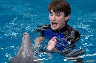 Sawyer (Nathan Gamble) plays with Winter