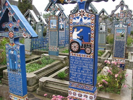 The colorful tombstone decorations in the Merry Cemetery bring an air of celebration to the rituals of death.