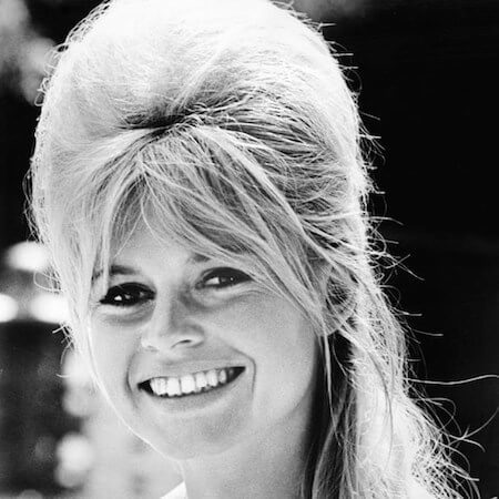 In the 1960s, Bridget Bardot wore her beehive half up, half down.