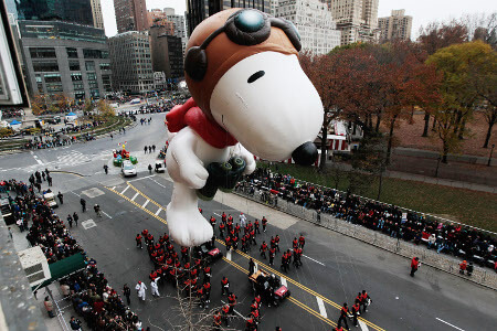 A giant Snoopy helium balloon at the Macy's parade