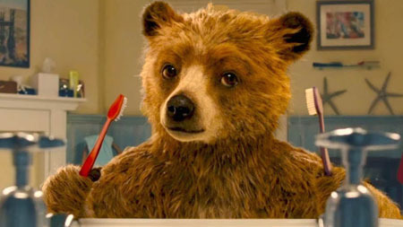 Paddington puzzles over a toothbrush