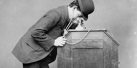 Edison's movies were first viewed through the above device, called a kinetoscope.