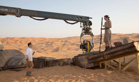 Daisy Ridley with director J.J. Abrams on set