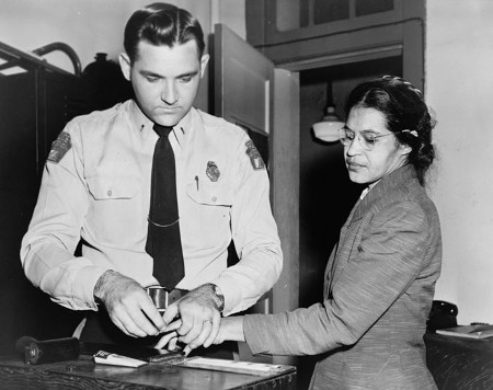 Rosa Parks being arrested for Civil Disobedience