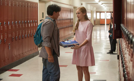 Thomas (Carlos Pratts) helps Julie (Morgan Saylor) with her books