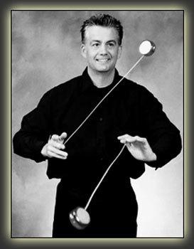 Donald Duncan playing with 2 Yo-Yo's