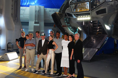 The cast poses in front of the Moon Tug