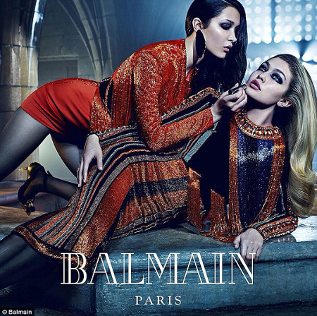 Bella helps Gigi with a touch-up in this Balmain shoot