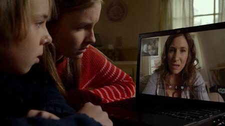 Ed, as Tyler, and sister Becca Skype their mom.