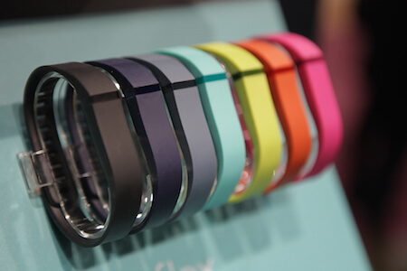 The Fitbit tracks your activity and comes in cool colors!