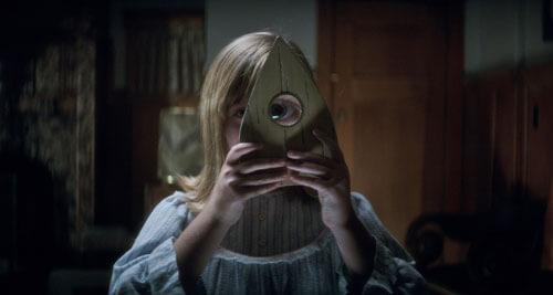 Doris looks through the Ouija planchette