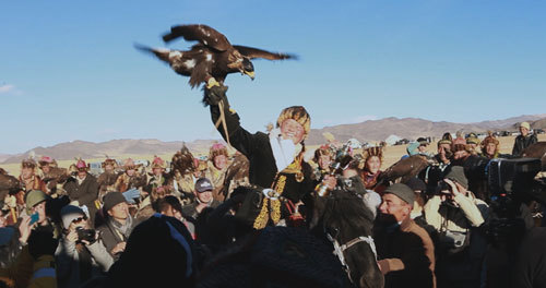 Aisholpan and her eagle at the hunting competition