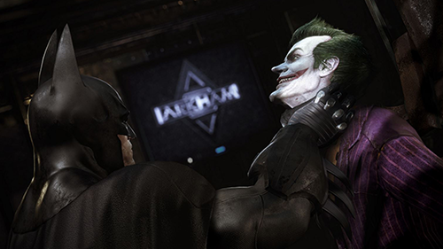 Batman fights the Joker in Arkham Asylum.
