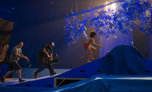 Film crew chases Neel as Mowgli on blue screen set