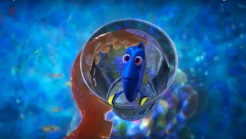 Hank the octopus holds Dory in a cup of water
