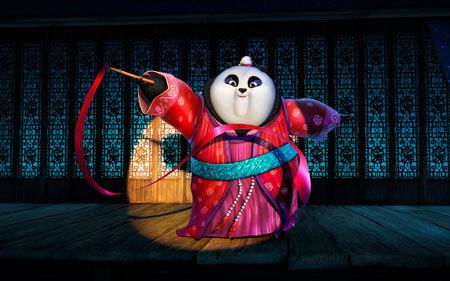 Ribbon dancer Mei Mei performs